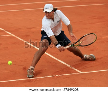 PARIS - MAY 23: Argentina's professional tennis player Eduardo Schwank during the match at French Open, Roland Garros on May 23, 2008 in Paris, France. - stock photo
