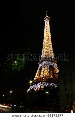 PARIS - May 30: Eiffel Tower at night on May 30, 2011. The Eiffel tower is the most visited monument of France with about 6 million visitors every year. - stock photo