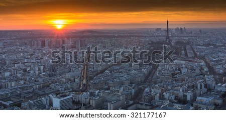 PARIS - MAY 1 : Eiffel Tower brightly illuminated at dusk on May 1 2013 in Paris. The Eiffel tower is the most visited monument of France. - stock photo