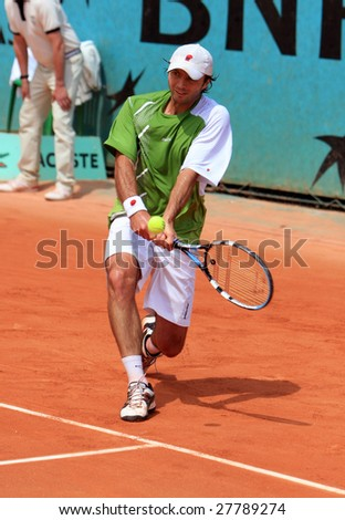 PARIS - MAY 23: Kazakhstan's professional tennis player Yuri Schukin returns the ball during the match at French Open, Roland Garros on May 23, 2008 in Paris, France. - stock photo