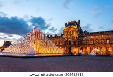 PARIS - MAY 10 : Louvre museum at twilight in summer on May 10,2014. Louvre museum is one of the world's largest museums - stock photo