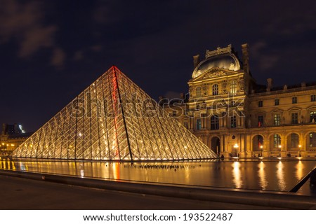 PARIS - MAY 9: Louvre Museum (Musee du Louvre) and the Pyramid in Paris, France, at night illumination on May 9, 2014. Louvre is the most famous  and visited Museum in Paris. - stock photo