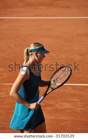 PARIS - MAY 29: Maria Sharapova of Russia during the match at French Open, Roland Garros on may 29, 2009 in Paris, France. - stock photo