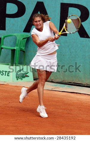 PARIS - MAY 21: Russia's Ekaterina Ivanova during the match at Roland Garros, French Open tennis tournament, May 21, 2008 in Paris, France - stock photo