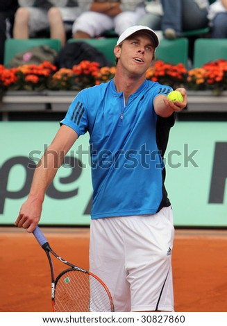 PARIS - MAY 23: Sam Querrey of USA in action  during the match at French Open, Roland Garros on May 23, 2009 in Paris, France. - stock photo