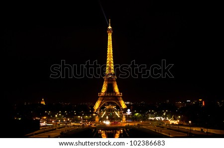 PARIS - MAY 09 The Eiffel tower at night on May 09, 2012 in Paris. The Eiffel tower is the most visited monument of France. - stock photo