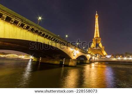 PARIS - NOV 1: Eiffel Tower Light Performance Show in Dusk on November 1, 2014. The Eiffel tower is the most visited monument of France.  - stock photo