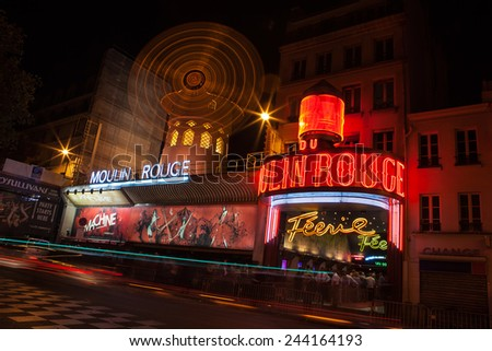 PARIS - NOV 24: The Moulin Rouge by night, on November 24, 2013 in Paris, France. Moulin Rouge is a famous cabaret built in 1889, locating in the Paris red-light district of Pigalle - stock photo