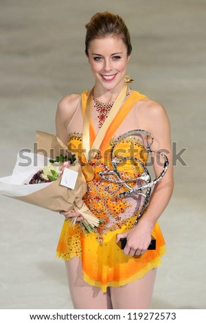 PARIS - NOVEMBER 17: Ashley WAGNER of USA poses at the medal ceremony after winning gold at Eric Bompard Trophy on November 17, 2012 at Palais-Omnisports de Bercy, Paris, France. - stock photo
