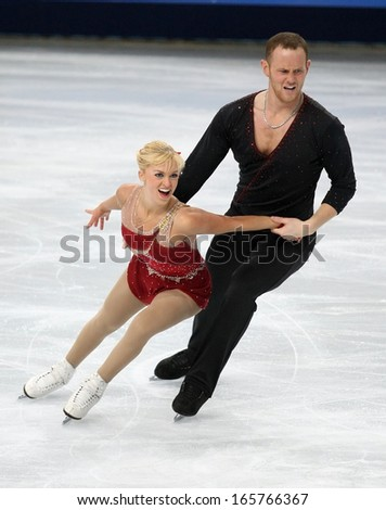 PARIS - NOVEMBER 15, 2013: Caydee DENNEY / John COUGHLIN of USA perform during pairs short skating event at Eric Bompard Trophy 2013  in Palais-Omnisports de Bercy, Paris, France. - stock photo