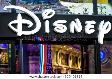PARIS - NOVEMBER 29, 2014: Disney Store in Paris, on the famous Champs Elysees boulevard. It is the international chain of specialty stores selling only Disney related items, many of them exclusive. - stock photo