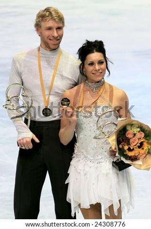 PARIS - NOVEMBER 15: France's ice dancers Isabelle Delobel / Olivier Schoenfelder pose during medal ceremony at ISU Grand Prix - Eric Bompard Trophy in Bercy, Paris, France on November 15, 2008. - stock photo