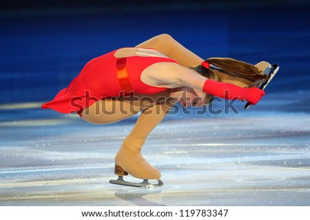 PARIS - NOVEMBER 18: Julia LIPNITSKAIA of Russia performs at the ISU Grand Prix Eric Bompard Trophy Gala event on November 18, 2012 at Palais-Omnisports de Bercy, Paris, France. - stock photo