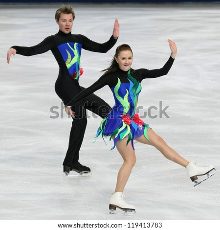 PARIS - NOVEMBER 16: Julia ZLOBINA / Alexei SITNIKOV of Azerbaijan perform short dance at the ISU Grand Prix Eric Bompard Trophy on November 16, 2012 at Palais-Omnisports de Bercy, Paris, France. - stock photo