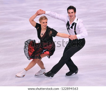 PARIS - NOVEMBER 16: Madison HUBBELL / Zachary DONOHUE of USA perform at ice dance short dance event at Eric Bompard Trophy on November 16, 2012 at Palais-Omnisports de Bercy, Paris, France. - stock photo