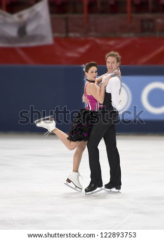 PARIS - NOVEMBER 16: Nathalie PECHALAT / Fabian BOURZAT of France perform at ice dance short dance event at Eric Bompard Trophy on November 16, 2012 at Palais-Omnisports de Bercy, Paris, France. - stock photo