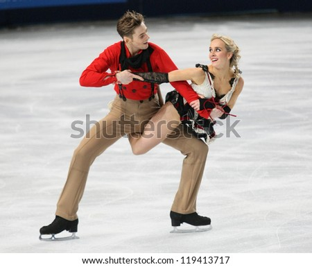 PARIS - NOVEMBER 16: Pernelle CARRON / Lloyd JONES of France perform short dance at the ISU Grand Prix Eric Bompard Trophy on November 16, 2012 at Palais-Omnisports de Bercy, Paris, France. - stock photo