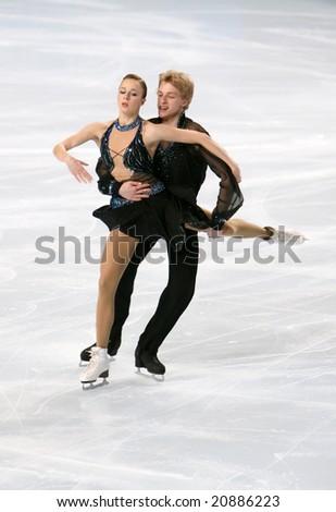 PARIS - NOVEMBER 14: Polish ice dancers Joanna BUDNER / Jan MOSCICKI perform original dance at Eric Bompard Trophy November 14, 2008 at Palais-Omnisports de Bercy, Paris, France. - stock photo