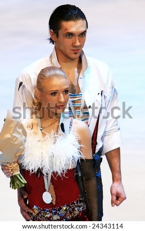 PARIS - NOVEMBER 15: Russian ice skaters Maria Mukhortova / Maxim Trankov pose during medal ceremony at ISU Grand Prix - Eric Bompard Trophy in Bercy, Paris, France on November 15, 2008. - stock photo