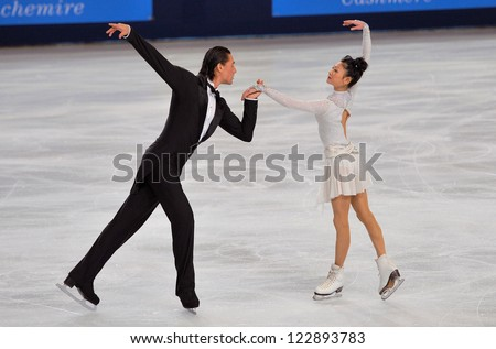 PARIS - NOVEMBER 16: Yuko KAVAGUTI / Alexander SMIRNOV of Russia perform at pairs short program event at Eric Bompard Trophy on November 16, 2012 at Palais-Omnisports de Bercy, Paris, France. - stock photo