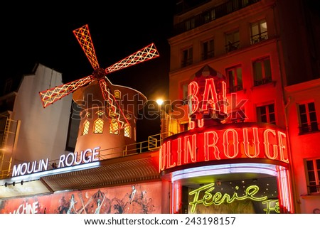 PARIS - OCT 2, 2012: The Moulin Rouge by night, in Paris.Moulin Rouge is a famous cabaret built in 1889, locating in the Paris red-light district of Pigalle  - stock photo