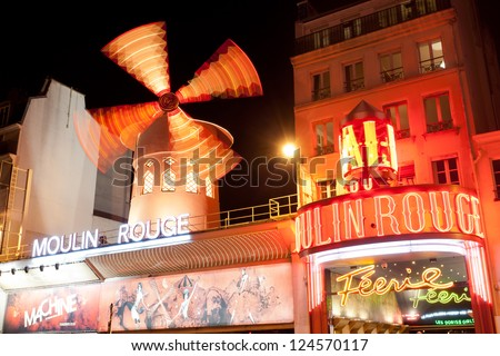 PARIS - OCT 2: The Moulin Rouge by night, on October 2, 2012 in Paris, France. Moulin Rouge is a famous cabaret built in 1889, locating in the Paris red-light district of Pigalle - stock photo