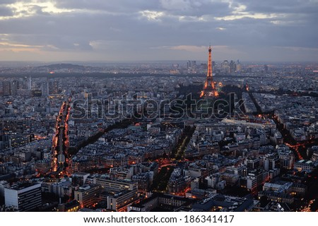 PARIS - OCTOBER 17, 2014: A panoramic shot of the Eiffel Tower and central Paris taken from the Montparnasse Tower after sunset in France on Oct 17th 2014. - stock photo