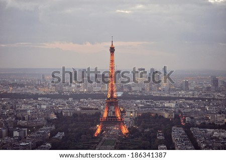 PARIS - OCTOBER 17, 2014: A panoramic shot of the Eiffel Tower taken from the Montparnasse Tower after sunset in Paris, France on Oct 17th 2014 - stock photo