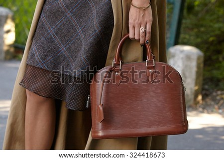 PARIS - OCTOBER 1: Brown leather bag before Chloe show, Paris Fashion Week Day 3, Spring / Summer 2016 street style on October 1, 2015 in Paris. - stock photo