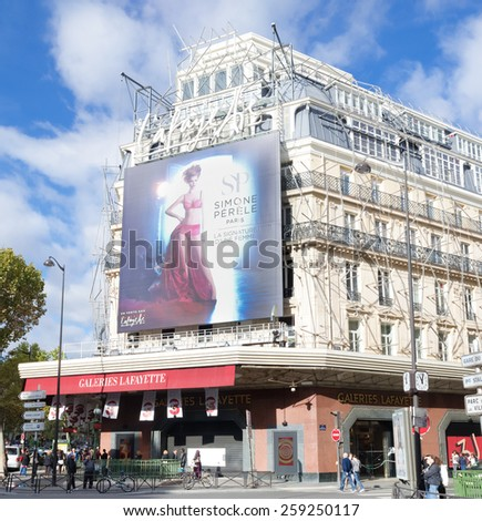 PARIS - OCTOBER 13, 2014: Entry of the famous Lafayette galeries. This is the most known and most prestigious one among the other department stores in over 60 french cities - stock photo