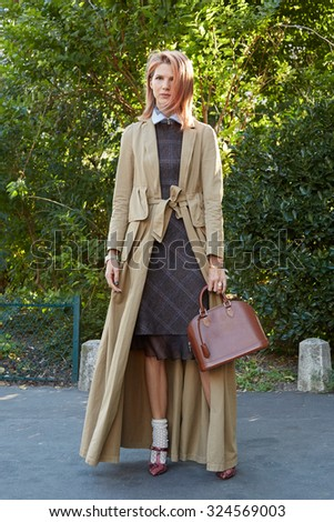 PARIS - OCTOBER 1: Samantha Angelo poses wearing a Dries Van Noten coat before Chloe show, Paris Fashion Week Day 3, Spring / Summer 2016 street style on October 1, 2015 in Paris. - stock photo