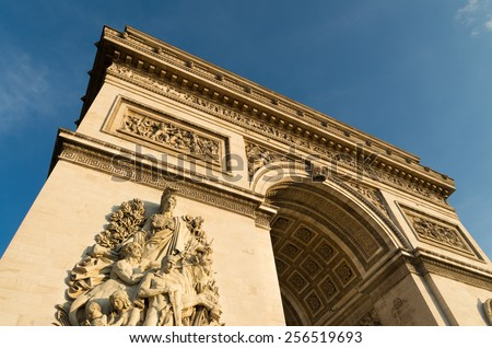 PARIS - OCTOBER 11, 2014: View on the famous arc de triomphe. Construction began in 1806, in honor of Napoleon's victory at Austerlitz. - stock photo
