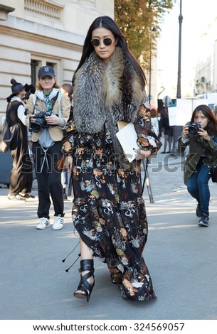 PARIS - OCTOBER 1: Woman poses for photographers before Chloe show, Paris Fashion Week Day 3, Spring / Summer 2016 street style on October 1, 2015 in Paris. - stock photo
