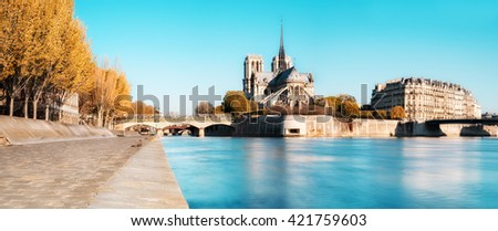Paris, panorama over river Seine with Notre-Dame Cathedral from the back on a bright day in Autumn. This image is toned. - stock photo