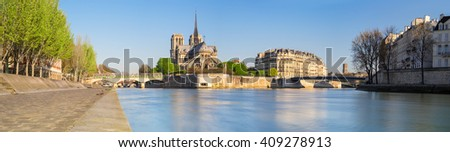 Paris, panorama over river Seine with Notre-Dame Cathedral from the back on a bright day in Spring. - stock photo
