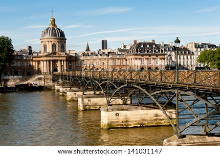 Paris, Pont des Arts in the bright Summer morning - stock photo