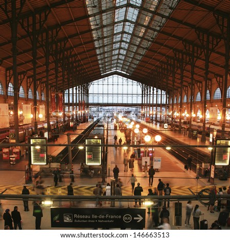 PARIS - SEP 27 : Inside view of Paris North Station, Gare du Nord, designed by Jacques Hittorff and completed at 1864 on Sep 27, 2010, Paris, France. The station serve about 190 million per year.  - stock photo