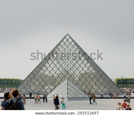 PARIS - SEPT 17, 2014: The Louvre IM Peis Pyramid. The Louvre Museum is one of the world's largest museums and a historic monument in Paris, France. A central landmark and popular place. - stock photo