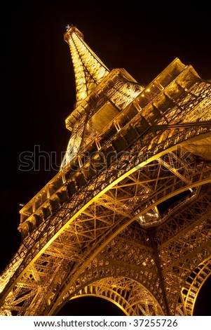 PARIS - SEPTEMBER 12: Details of the illuminated Eiffel Tower by night. The most recognizable landmark of the world. September 12, 2009 in Paris, France. - stock photo