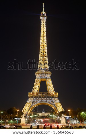 PARIS - September 29, 2015: Eiffel tower by night, flashing light performance show on September 29, 2015 in Paris. The tower is the tallest structure in Paris and the most-visited paid monument. - stock photo