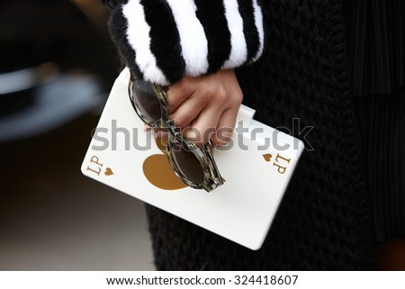 PARIS - SEPTEMBER 30: Heart card bag before Rochas show, Paris Fashion Week Day 2, Spring / Summer 2016 street style on September 30, 2015 in Paris. - stock photo