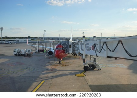 PARIS - SEPTEMBER 03: jet flight docked in Orly Airport on September 03, 2014 in Paris, France. Paris Orly Airport is an international airport located partially in Orly, south of Paris - stock photo