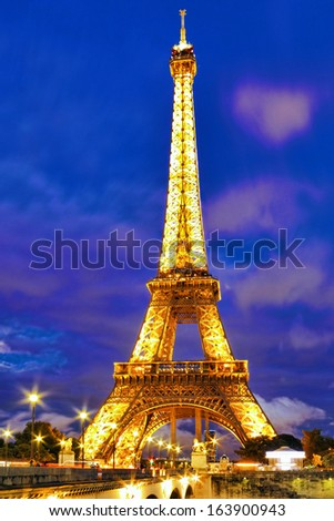 PARIS - SEPTEMBER 18. Light Performance Show on September 18, 2013 in Paris. The Eiffel Tower stands 324 metres (1,063 ft) tall. Monument was built in 1889, night view of the Yen Bridge - stock photo