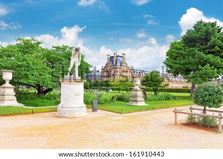 PARIS - SEPTEMBER 18: Louvre museum and park des Tuileries  on September, 18, 2013. The Louvre is the biggest museum in Paris with nearly 35,000 objects from prehistory to the 19th century . - stock photo