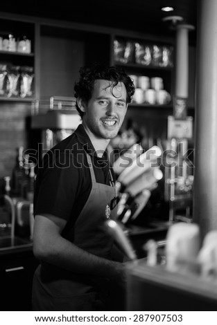 PARIS - SEPTEMBER 09: Starbucks cafe barman on September 09, 2014 in Paris, France. Starbucks is the largest coffeehouse company in the world, with more then 23000 stores - stock photo
