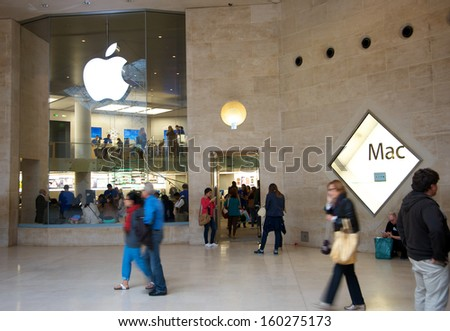 PARIS - SEPTEMBER 18: The Apple Store at the Carrousel du Louvre Museum. Interesting contrast of the latest technology and classic art, both loved by millions around the world, on September 18, 2013. - stock photo