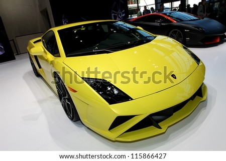 PARIS - SEPTEMBER 30: The Lamborghini Gallardo LP 560-4 and the Supeleggera (in the background) displayed at the 2012 Paris Motor Show on September 30, 2012 in Paris - stock photo