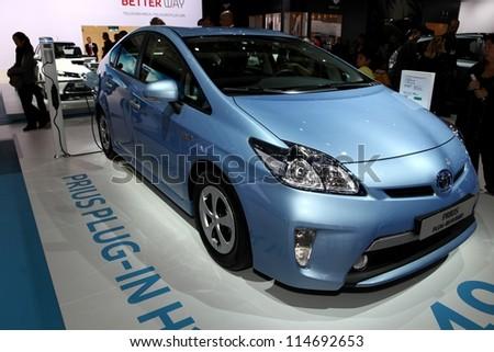 PARIS - SEPTEMBER 30: The new Toyota Prius Plug-in Hybrid displayed at the 2012 Paris Motor Show on September 30, 2012 in Paris - stock photo