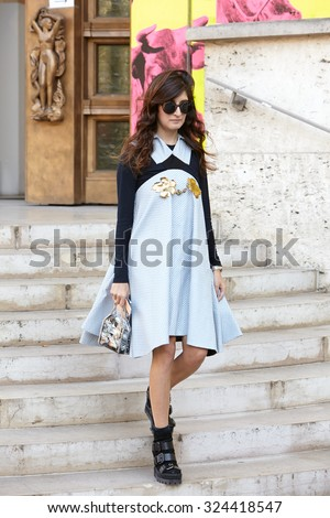 PARIS - SEPTEMBER 30: Woman poses for photographers before Rochas show, Paris Fashion Week Day 2, Spring / Summer 2016 street style on September 30, 2015 in Paris. - stock photo