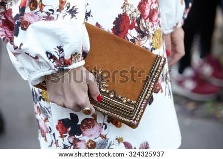 PARIS - SEPTEMBER 30: Woman with decorated bag poses for photographers before Yang Li show, Paris Fashion Week Day 2, Spring / Summer 2016 street style on September 30, 2015 in Paris. - stock photo